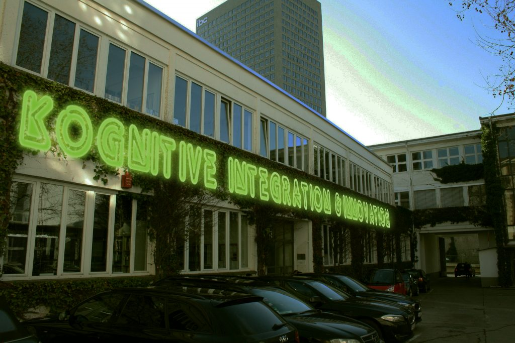 The image shows a modified photograph of the headquartes of the Institute for Social-Ecological Research (ISOE) in Frankfurt/Main.